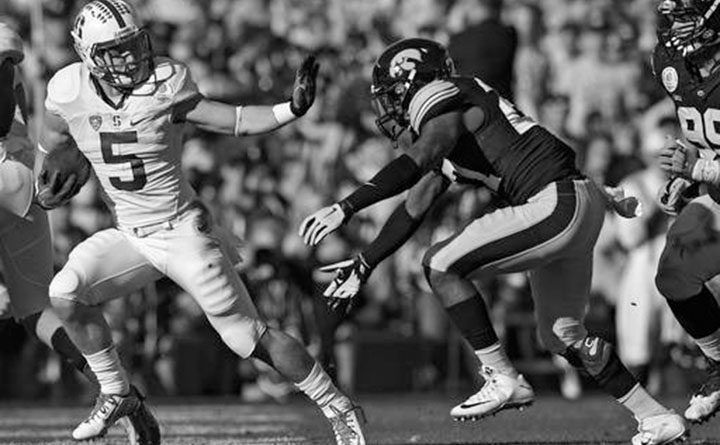 """FILE - In this Jan. 1, 2016, file photo, Stanford running back Christian McCaffrey, left, runs past Iowa defensive back Jordan Lomax during the first half of the Rose Bowl NCAA college football game, in Pasadena, Calif. Now here's a scary thought for defenses facing Stanford this season. One year after shattering Barry Sanders' 27-year-old record for all-purpose yards in a season, Heisman Trophy runner-up McCaffrey is back for his junior season as a """"significantly"""" better player, according to his coach. (AP Photo/Mark J. Terrill, File)"""